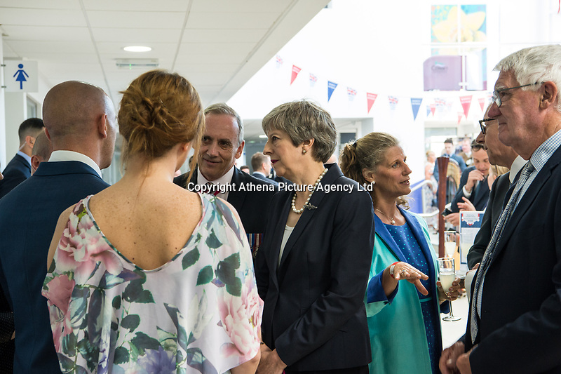 Today, HRH Rt Hon Theresa May talks with Blind Veterans at The Venue Cymru, Llandudno to celebrate Armed Forces Day.<br /> <br /> Saturday 30th June 2018, saw hundreds of events held to mark the tenth annual Armed Forces Day, including parades and ceremonies right across the country. Men and women from the Royal Navy, British Army and Royal Air Force, both regulars and reserves, are being recognised alongside the wider defence family including cadets and veterans.<br /> <br /> The national event in Llandudno, North Wales was attended by Her Royal Highness Princess Anne, the Princess Royal representing The Queen and the Royal Family, the Prime Minister Theresa May and the Defence Secretary Gavin Williamson, along with other senior politicians. <br /> <br /> A parade of around 1,000 serving personnel, veterans, cadets and marching bands set off from the Llandudno War Memorial at 11am to signal the start of the Armed Forces Day celebrations.<br /> <br /> Also present were many veterans that make-up the estimated 2.56 million Armed Forces veteran community living in the UK. Young Cadets were also present; together the Sea, Army, and Air cadets have almost 100,000 members.
