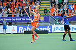 The Hague, Netherlands, June 14: Maartje Paumen #17 of The Netherlands celebrates after scoring a penalty shot (1-0) during the field hockey gold medal match (Women) between Australia and The Netherlands on June 14, 2014 during the World Cup 2014 at Kyocera Stadium in The Hague, Netherlands. Final score 2-0 (2-0)  (Photo by Dirk Markgraf / www.265-images.com) *** Local caption ***