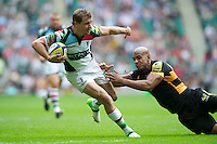 Nick Evans of Harlequins evades the tackle of Tom Varndell of London Wasps to score a try during the Aviva Premiership match between London Wasps and Harlequins at Twickenham on Saturday 1st September 2012 (Photo by Rob Munro).