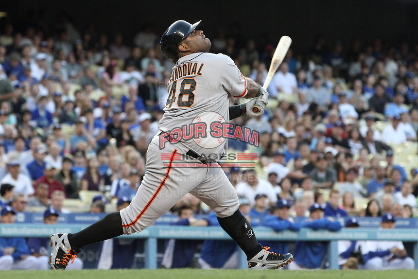Pablo Sandoval #48 of the San Francisco Giants bats against the Los Angeles Dodgers at Dodger Stadium on June 25, 2013 in Los Angeles, California. (Larry Goren/Four Seam Images)