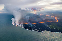 lava erupts from fissure 8 (Puka Ewalu) of the Kilauea Volcano east rift zone in Leilani Estates subdivision, near Pahoa, and flows as a glowing river through agricultural plots to enter the ocean just south of Cape Kumukahi, Kapoho, Puna, Big Island, Hawaii, USA, Pacific Ocean