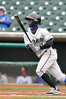 Pedro Ciriaco #12 of the Omaha Storm Chasers swings against the Iowa Cubs at Principal Park on May 1, 2014 in Des Moines, Iowa. The Cubs  beat Storm Chasers 1-0.   (Dennis Hubbard/Four Seam Images)