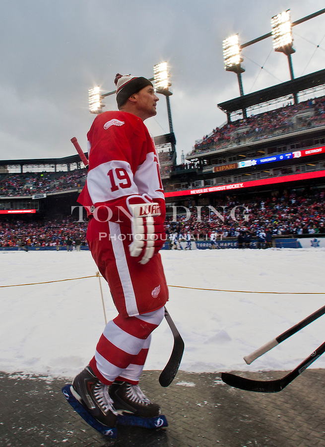 31 December 2013: Former Detroit Red Wings forward and former captain Steve Yzerman (19) walks towards the dressing room after warmups before the Toronto Maple Leafs v Detroit Red Wings Alumni Showdown hockey game, at Comerica Park, in Detroit, MI.