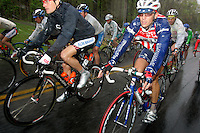 David Zabriskie (left) of Team CSC, and Justin England, of Toyota-United Pro, ride with the peoloton through rain storms during Stage 5 of the Ford Tour de Georgia. Tom Danielson, of the Discovery Channel Pro Cycling Team, won the 94.5-mile (152.1-km) stage from Blairsville to the top of Brasstown Bald, the highest point in the state. Zabriskie finished 13th and England finished 9th.<br />