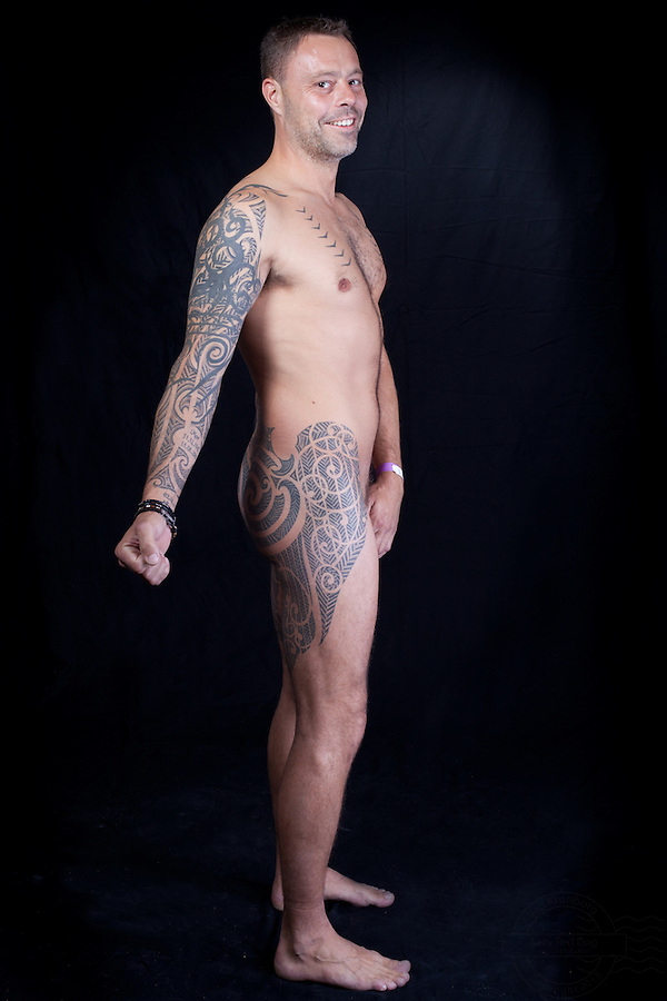 Danish man, with extensive tattoos on lower back, thighs, hips and right arm. Tribal style.<br />