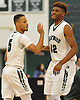 Michael Almonacy #5 of Brentwood, left, and teammate Jamel Allen #42 react after Almonacy drained a three-pointer to break the school scoring record of 1,380 points during a Suffolk County varsity boys' basketball game against Floyd at Brentwood High School on Thursday, Jan. 7, 2016. The previously held mark was set by Mitch Kupchak, current General Manager of the Los Angeles Lakers. Almonacy, a senior who committed to playing NCAA men's basketball for Stony Brook University, finished with 18 points in Brentwood's 104-48 win.