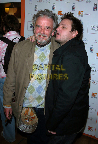 "DAVID BAILEY, IAN RANKIN.""Rankin And Bailey Down Under"" private view at Proud Camden Moss, London, UK..May 1st, 2003.half length black brown jacket argyle diamond pattern.CAP/PL.©Phil Loftus/Capital Pictures"