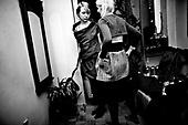 Wroclaw 01.2010 Poland<br /> Transsexual Marina Till prepares to go on the party.<br /> Marina Till, a transsexual, has had numerous medical examinations and treatments, such as a very intense hormonal therapy, at times seriously weakening her organism. For a long time she has been dreaming  about a sex change surgery that she can not afford. She does not accept herself and her body. Frequent suicide attempts and alcohol abuse, are means of escape from the body she lives in. A body that does not belong to her.<br /> Photo: Adam Lach / Napo Images<br /> <br /> Transseksualista Marina Till przygotowuje sie do wyjscia na impreze.<br /> Transseksualista Marina Till przeszla juz setki kuracji hormonalnych i badan psychoterapeutycznych, ktore w znaczny sposob wycienczyly jej organizm. Od wielu lat marzy o zmianie plci lecz najzwyczajniej nie stac ja na zbyt kosztowna operacje. Nie akceptuje siebie, nie akceptuje swojego ciala. Czeste proby samobojcze i znaczne ilosci alkoholu sa dla niej sposobem na ucieczke, przede wszystkim od swiadomosci ze cialo w ktorym zyje nie nalezy do niej.<br /> Fot: Adam Lach / Napo Images