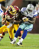 Dallas Cowboys running back Felix Jones (28) is tackled by Washington Redskins linebacker Rocky McIntosh (52) in first quarter action at FedEx Field in Landover, Maryland on Sunday, September 12, 2010. .Credit: Ron Sachs / CNP