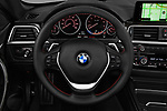 Car pictures of steering wheel view of a 2018 BMW 4 Series 430i 2 Door Convertible