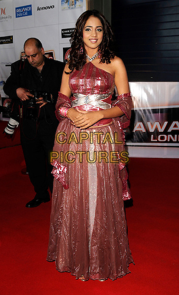 MAULI.Attending the Zee Cine Awards, .Excel Centre, London, England, .April 26th 2008..full length red pink shiny Indian style dress wrap.CAP/CAN.©Can Nguyen/Capital Pictures