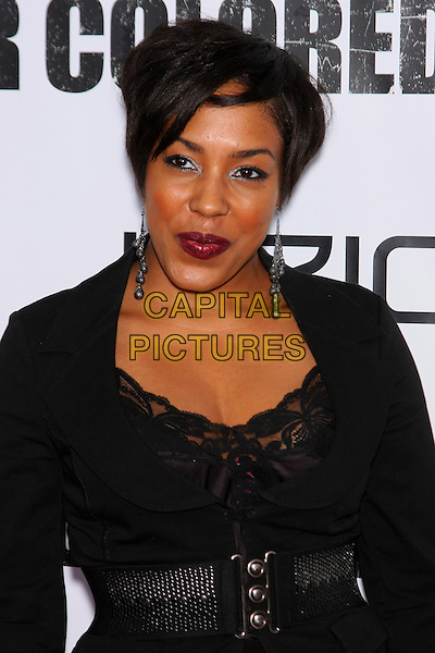 DE'ADRE AZIZA.The New York Special Screening of 'For Colored Girls' at Ziegfeld Theatre in New York City, New York, NY, USA. .25th October 2010.half length black lace top jacket belt silver dangling earrings .CAP/LNC/TOM.©TOM/LNC/Capital Pictures.