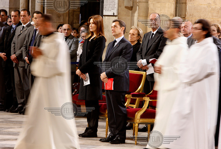 President Sarkozy and his wife Carla Bruni attending a requiem mass at Notre Dame Cathedral.