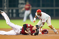 Houston Astros shortstop Tyler Greene #27 is upended by Phillies baserunner Jimmy Rollins #11 during the Major League baseball game against the Philadelphia Phillies on September 16th, 2012 at Minute Maid Park in Houston, Texas. The Astros defeated the Phillies 7-6. (Andrew Woolley/Four Seam Images)..