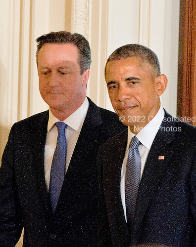 United States President Barack Obama, right, and Prime Minister David Cameron of the United Kingdom, left, arrive for a joint press conference in the East Room of the White House in Washington, D.C. on Friday, January 16, 2015. During the course of the press conference the leaders touched on issues such as cybersecurity, terrorism, ISIL and the economy.<br /> Credit: Ron Sachs / Pool via CNP