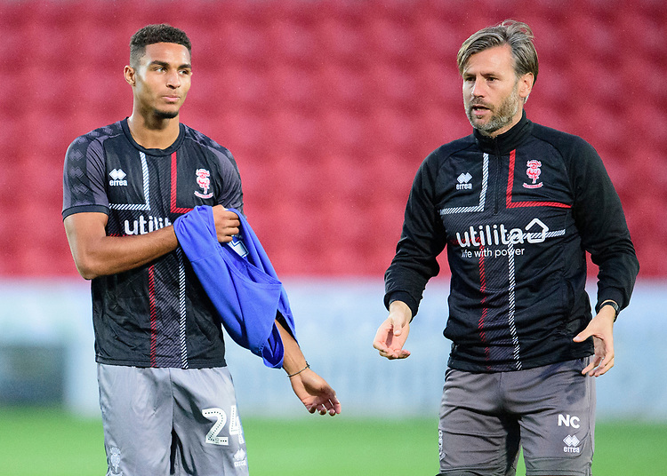 Lincoln City's Max Melbourne, left, gets instructions from Nicky Cowley<br /> <br /> Photographer Andrew Vaughan/CameraSport<br /> <br /> EFL Leasing.com Trophy - Northern Section - Group H - Doncaster Rovers v Lincoln City - Tuesday 3rd September 2019 - Keepmoat Stadium - Doncaster<br />  <br /> World Copyright © 2018 CameraSport. All rights reserved. 43 Linden Ave. Countesthorpe. Leicester. England. LE8 5PG - Tel: +44 (0) 116 277 4147 - admin@camerasport.com - www.camerasport.com
