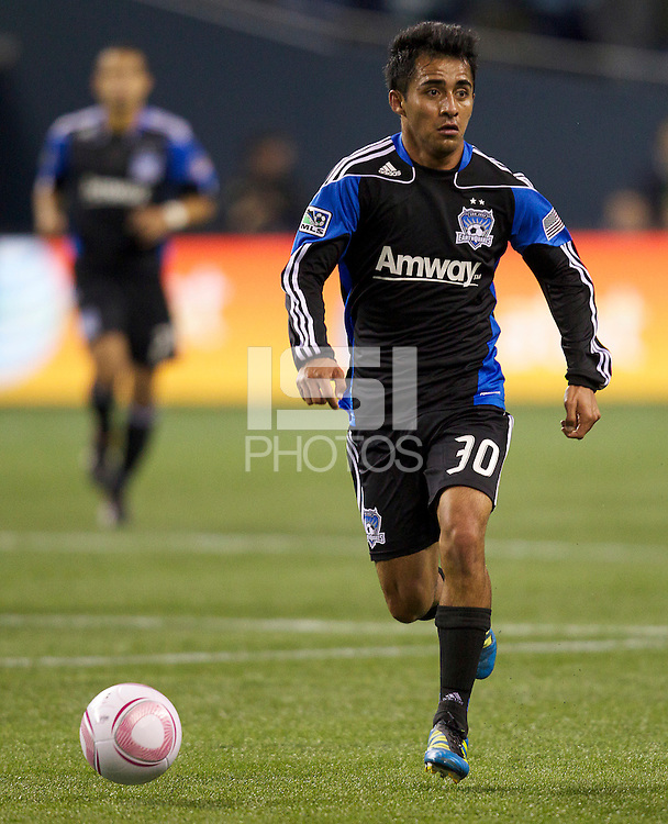 Rafael Baca of the San Jose Earthquakes dribble the ball up field during play between the Seattle Sounders FC and the San Jose Earthquakes at CenturyLink Field in Seattle Saturday October 15, 2011. The Sounders FC won the game 2-1.
