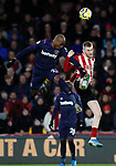 Angelo Ogbonna of West Ham United and Oli McBurnie of Sheffield Utd during the Premier League match at Bramall Lane, Sheffield. Picture date: 10th January 2020. Picture credit should read: Simon Bellis/Sportimage