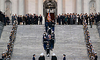 The casket carrying former president George Herbert Walker Bush is carried up the steps of the US Capitol in Washington, Monday, Nov. 3, 2018.  President Bush who died at the age 94, will lie in state in the Capitol Rotunda until Wednesday morning.    <br /> CAP/MPI/RS<br /> &copy;RS/MPI/Capital Pictures