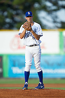 Burlington Royals starting pitcher Corey Ray (64) looks to his catcher for the sign against the Greeneville Astros at Burlington Athletic Park on June 30, 2014 in Burlington, North Carolina.  The Royals defeated the Astros 9-8. (Brian Westerholt/Four Seam Images)