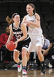 SIOUX FALLS, SD - MARCH 6: Remy Davenport #33 of Omaha looks to pass around defender Jenna Gunn #32 of IUPUI in the 2016 Summit League Tournament.  (Photo by Dick Carlson/Inertia)