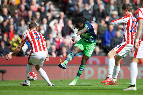 02.04.2016. Britannia Stadium, Stoke, England. Barclays Premier League. Stoke City versus Swansea City.  Swansea City forward Bafetimbi Gomis shoots past Stoke City defender Erik Pieters.