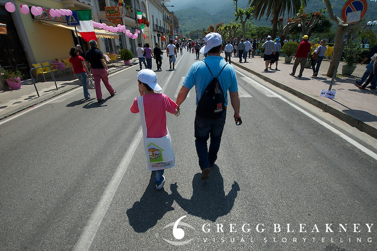 A father walks his son to the stage 8 starting area.