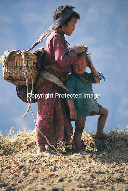 These children live in Gumba, which is a village in the central northern part of Nepal, not far from the border with Tibet. It is at about 8,000 feet and two days' walk on a steep and narrow mountain track from the nearest road. Everything must be carried in and out on the backs of the villagers or their few animals.