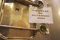 A sign on one of the stainless steel fermentation tanks saying Chapelle de Potensac 2004, detail Chateau Potensac Cru Bourgeois Ordonnac Medoc Bordeaux Gironde Aquitaine France