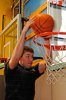 "30 September, 2010, Kansas City, Kansas USA.Denny Hamlin ""slam dunks"" the ball at The College Basketball Experience..©2010, F. Peirce Williams, USA."