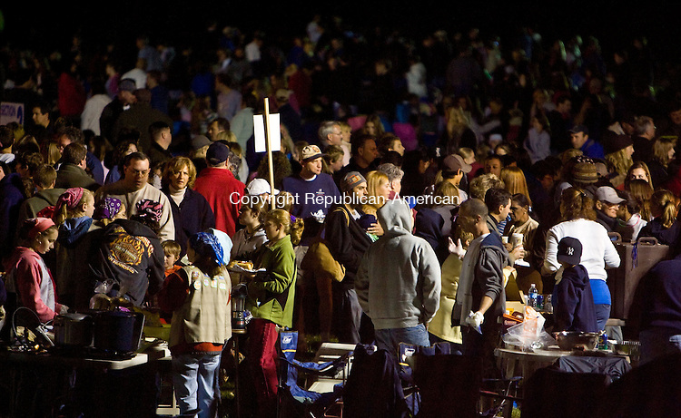 SOUTHBURY, CT - 04 OCTOBER 2008 -100408JT01--<br /> Crowds of people gather around food vendors on Saturday night during the 10th annual Southbury Celebration at Lake Stibbs at the Southbury Training School. The event featured food, music, and fireworks.<br /> Josalee Thrift / Republican-American