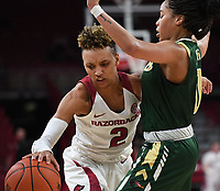 NWA Democrat-Gazette/J.T. WAMPLER Arkansas' Alexis Tolefree drives to the basket while University of Alabama at Birmingham's Miyah Barnes defends Sunday March 24, 2019 at Bud Walton Arena in Fayetteville during the second round of the Women's National Invitational Tournament. Arkansas won 100-52 and takes on TCU Thursday night at home.