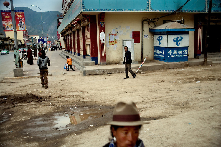People walk along the streets of Xiahe, Ganus, China.  Xiahe, home of the Labrang Monastery, is an important site for Tibetan Buddhists.  The population of the town is divided between ethnic Tibetans, Muslims, and Han Chinese.