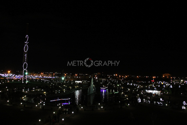 IRAQ, ERBIL:  A large sign with 2010 written in florescent light stands over Sami Abdulramin Park in Erbil...Revelers brought in the new year all across Kurdistan with shows of fireworks and enormous street parties...Photo by Safeq Shukre/Metrography