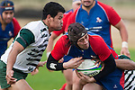 Carwyn Chase braces for the tackle from Hunu Tupai. Counties Manukau Premier Club Rugby game between Ardmore Marist and Manurewa, played at Bruce Pulman Park, Papakura on Saturday July 18th 2009..Ardmore Marist won the game 32 - 5 after leading 10 - 5 at halftime.