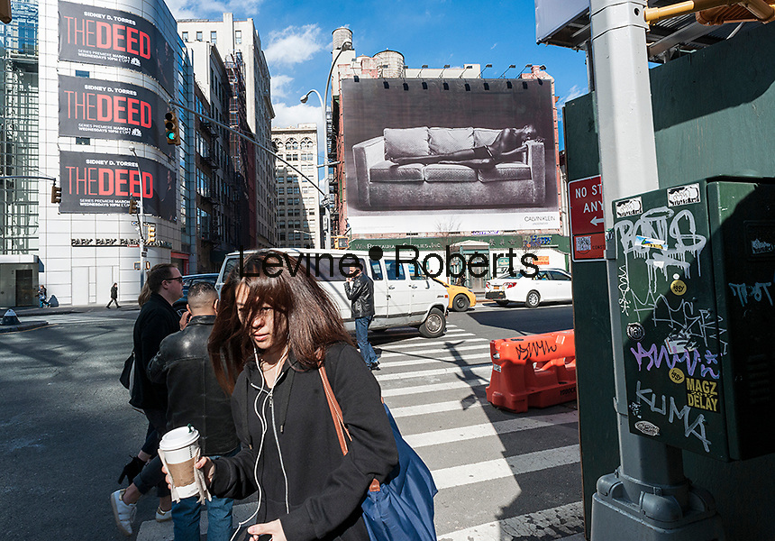 A billboard advertising Calvin Klein brand underwear in the Soho neighborhood of New York on Wednesday, March 8, 2017. Klein's advertisements use sex and provocative images to test society's cultural and moral boundaries. (© Richard B. Levine)