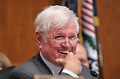 """Washington, D.C. - January 9, 2009 -- United States Senator Edward M. """"Ted"""" Kennedy (Democrat of Massachusetts) laughs during a light moment as he listens to the questioning of United States Representative Hilda L. Solis (Democrat of California) during her testimony before the United States Senate Committee on Health, Labor, Education, and Pensions on her nomination to be United States Secretary of Labor in Washington, D.C. on Friday, January 9, 2009..Credit: Ron Sachs / CNP"""
