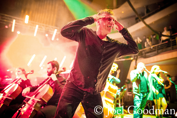 "© Joel Goodman - 07973 332324 . 05/02/2016 . Manchester , UK .  "" Hacienda Classical "" debut at the Bridgewater Hall . The 70 piece Manchester Camerata and performers including New Order's Peter Hook , Shaun Ryder , Rowetta Idah , Bez and Hacienda DJs Graeme Park and Mike Pickering mixing live compositions . Photo credit : Joel Goodman"