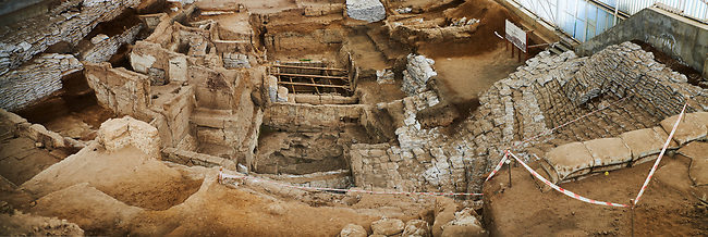 looking down from the highest point of the south area across the Neolithic remains of mud brick houses walls. In the centre it can be seen how deep the excavation has gone so far. 7500 BC to 5700 BC. Catalyhoyuk Archaeological Site, Çumra, Konya, Turkey