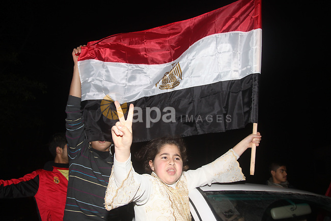Palestinians celebrate the news of the resignation of President Hosni Mubarak, who handed control of the country to the military, at night in Gaza city, Friday, Feb. 11, 2011 Photo by Mohamed Asad