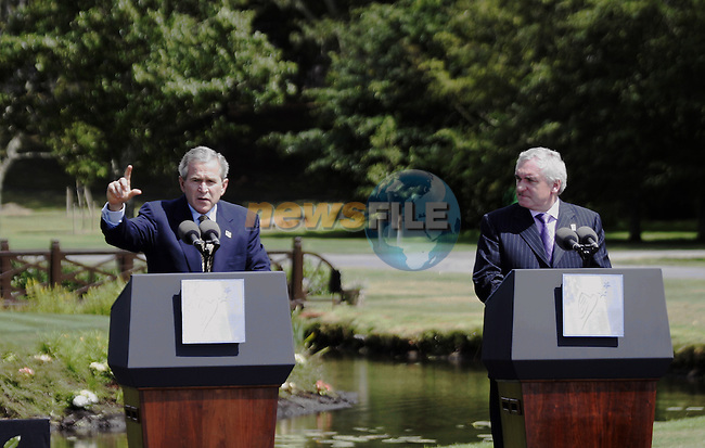US President George W Bush (L) and Irish Prime minister Bertie Ahern,current chairman of the Council,are pictured 26 of june 2004 at the Dromoland Castle (near Shannon West Ireland) during the final press conference of the  the UE-USA Summit. AFP PHOTO GERARD CERLES