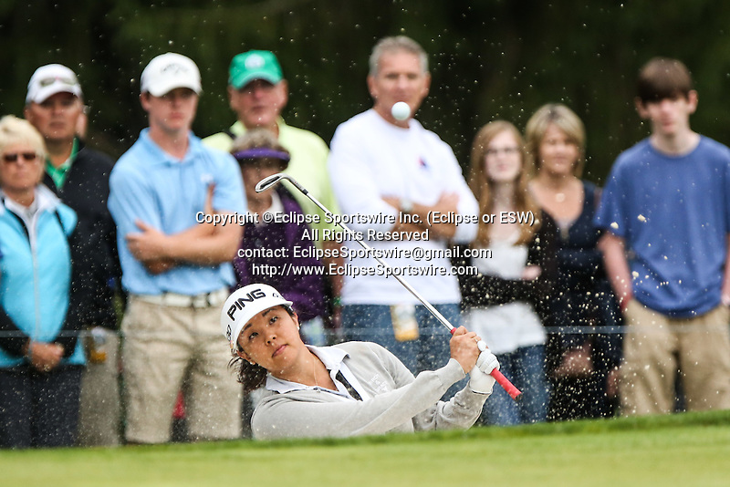 Jane Park hits her ball out of the bunker and onto the 2nd green at the LPGA Championship 2014 Sponsored By Wegmans at Monroe Golf Club in Pittsford, New York on August 16, 2014