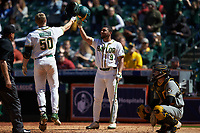 Mack Mueller (50) of the Baylor Bears is greeted at home plate by teammate Davion Downey (9) after hitting a home run against the Missouri Tigers in game one of the 2020 Shriners Hospitals for Children College Classic at Minute Maid Park on February 28, 2020 in Houston, Texas. The Bears defeated the Tigers 4-2. (Brian Westerholt/Four Seam Images)