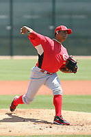 Juan Carlos Sulbaran #15 of the Cincinnati Reds pitches in a minor league spring training game against the Cleveland Indians at the Reds minor league complex on March 27, 2011  in Goodyear, Arizona. .Photo by:  Bill Mitchell/Four Seam Images.