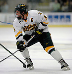 6 January 2007: University of Vermont forward and co-captain Torrey Mitchell (9) from Greenfield Park, QC, in action against the University of New Hampshire Wildcats at Gutterson Fieldhouse in Burlington, Vermont. The Wildcats defeated Vermont 2-1 to sweep the two-game weekend series in front of a record setting 49th consecutive sellout at the Gut...Mandatory Photo Credit: Ed Wolfstein Photo.<br />