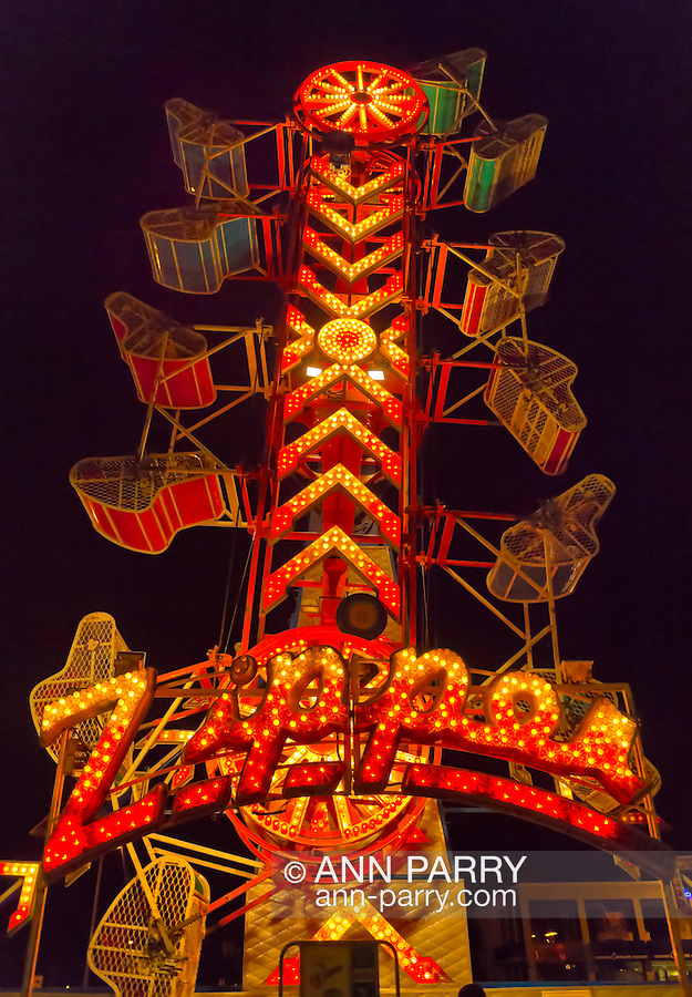 August 7, 2012 - Merrick, New York, U.S. - Riders spin high in metal cages while riding the Zipper, on the first night of the 22nd Annual Merrick Festival on Long Island.