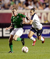 Irish midfielder Mary McDonnell (17) trips US forward Carli Lloyd (11).  The US Women's National Team defeated Ireland 2-0 at Toyota Park in Bridgeview, IL on September 20, 2008.  Photo by Tracy Allen/isiphotos.com
