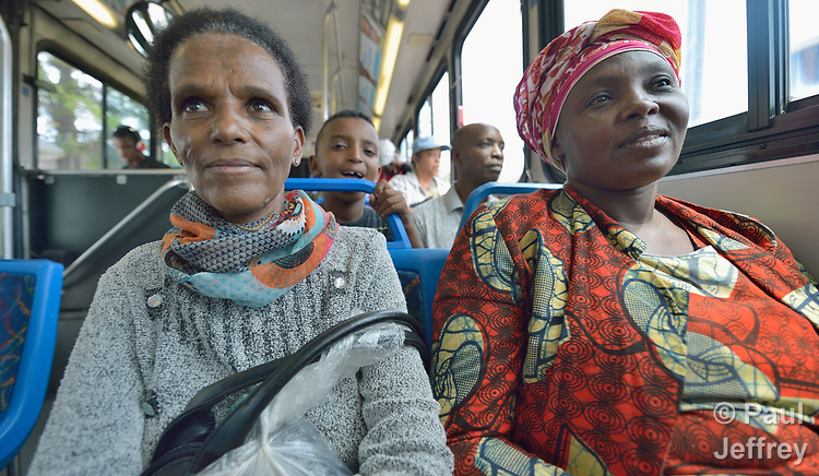Ethiopia Beru (left) and Evanis Gatunzi, resettled refugees from Eritrea and Rwanda, respectfully, ride a public bus in Durham, North Carolina. <br /> <br /> The two women were resettled in Durham by Church World Service, which resettles refugees in North Carolina and throughout the United States.<br /> <br /> <br /> Photo by Paul Jeffrey for Church World Service.