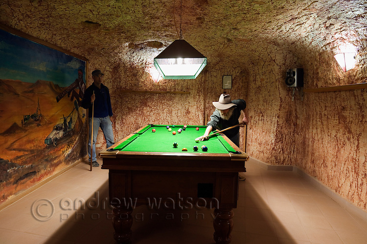 Underground billiards room at Radeka's Downunder Dugout Motel.  Coober Pedy, South Australia, AUSTRALIA.  © Andrew Watson / Axiom