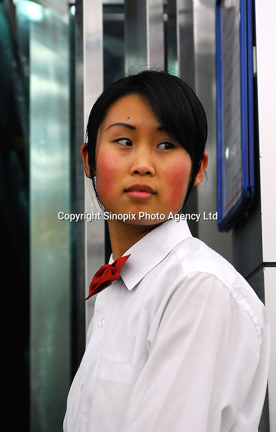 A waitress in bow tie at a resteraunt in the city of Xining, China. Xining is a muslim dominated city and the capital of Qinghai Province in China.....